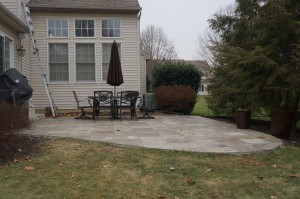 Before photo of patio and yard.