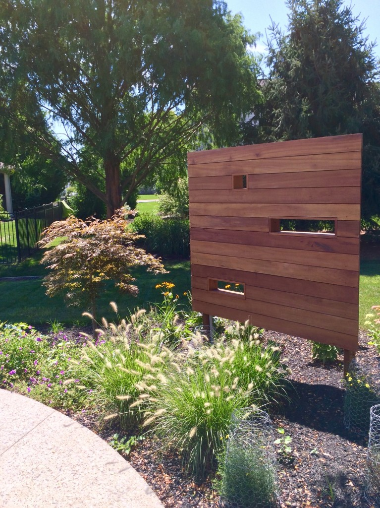 Tigerwood privacy screen conceals LED lights.